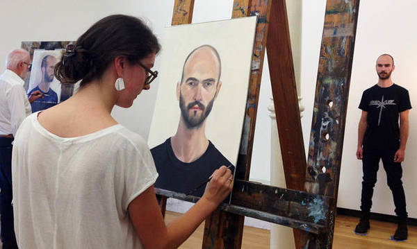 Student participating in portrait painting alla prima
